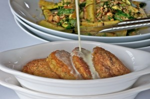 Risotto cakes with mushroom cream sauce