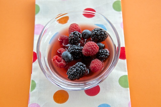 Berries with cava-honey syrup