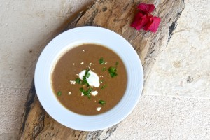 Black beans soup with cotija cheese and crema