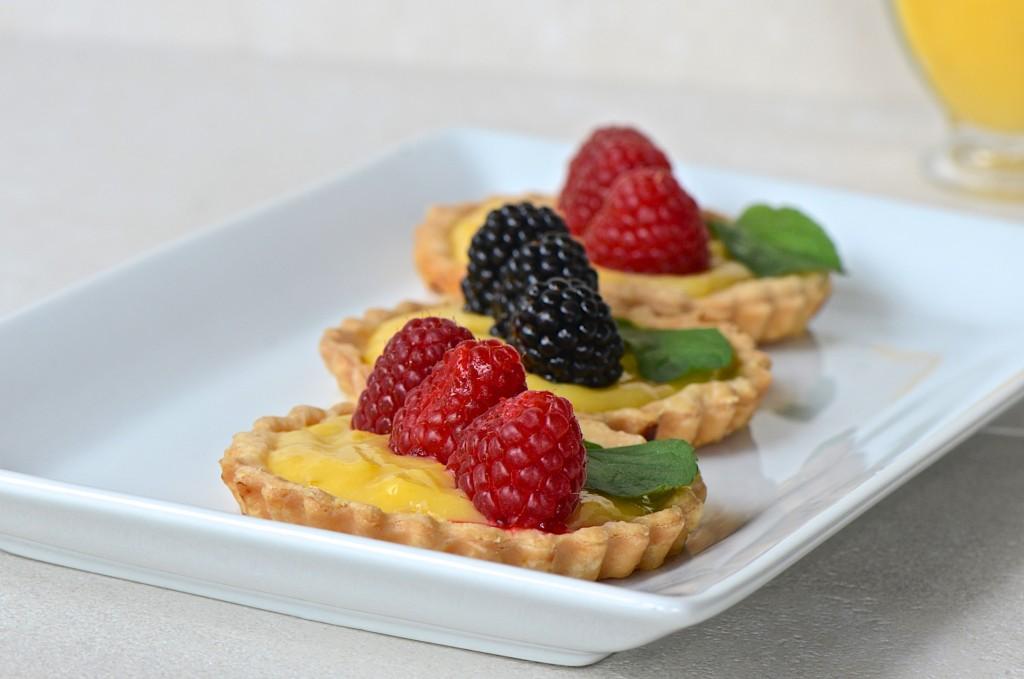 Lemon curd tarts with berries