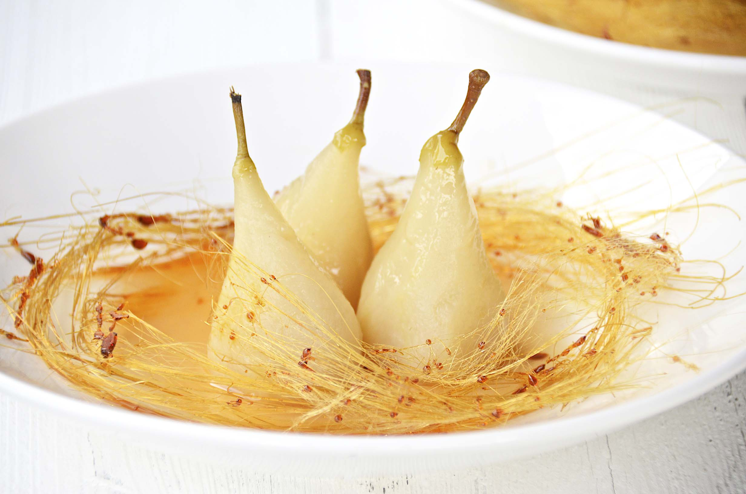 poached pears with spun sugar