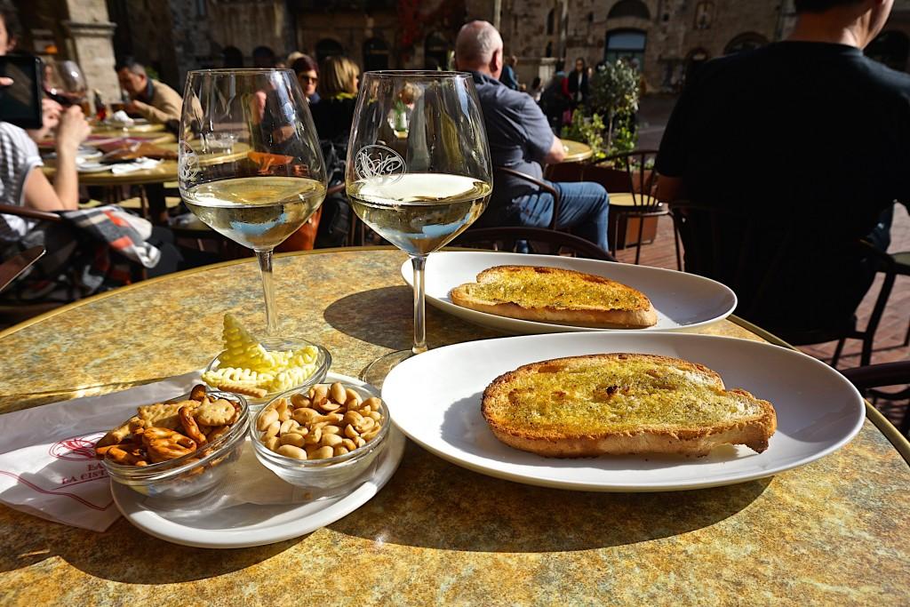 VA glass of Vernaccia at the Piazza della Cisterna