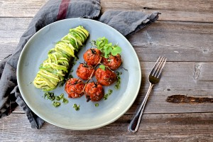 """Zucchini """"noodles"""" with parsley pesto and roasted tomatoes on the vine"""