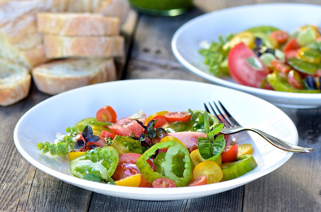 Heirloom tomato salad with Mona's basil vinaigrette
