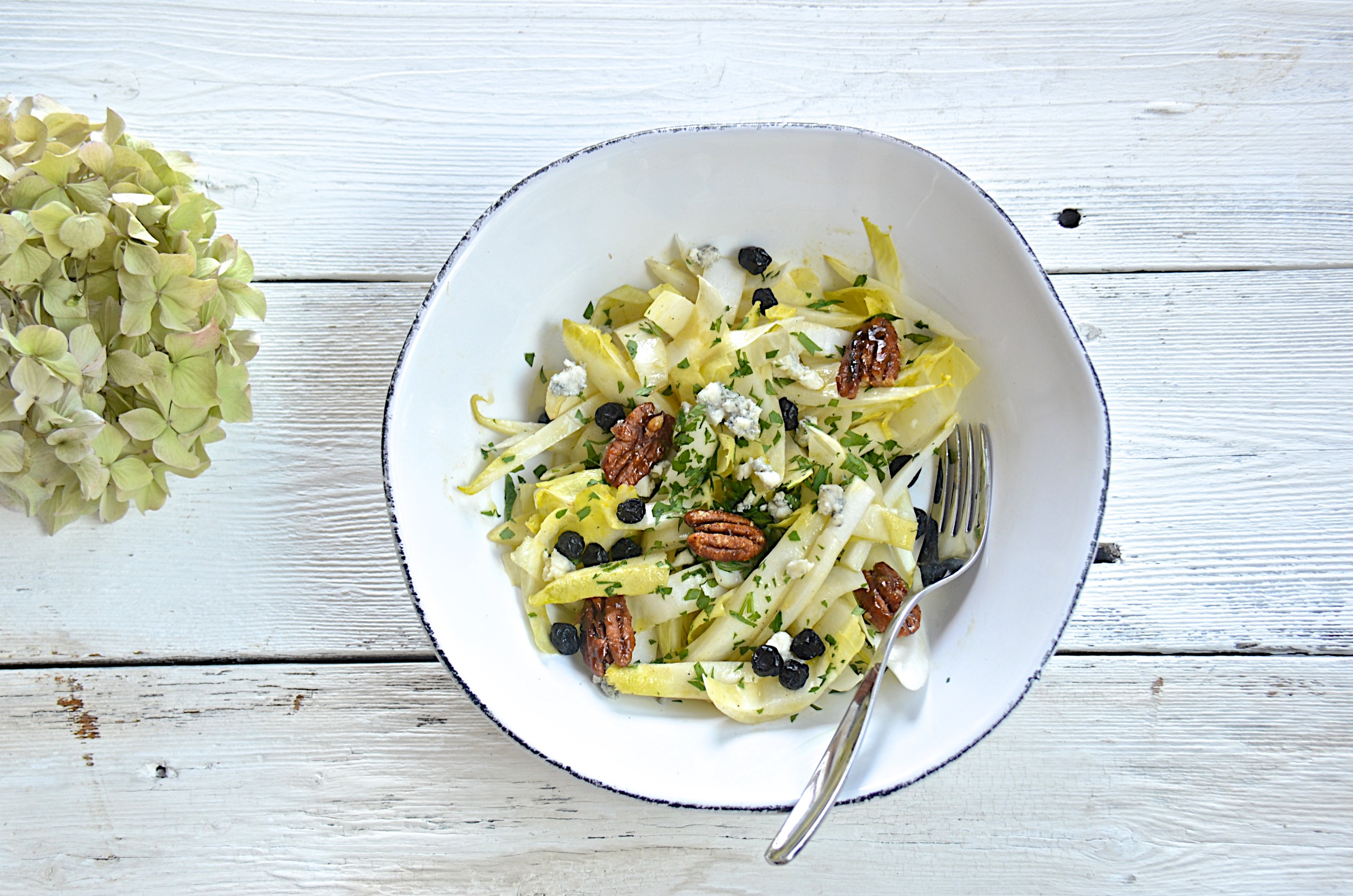 Endive salad with candied nuts and creamy vinaigrete