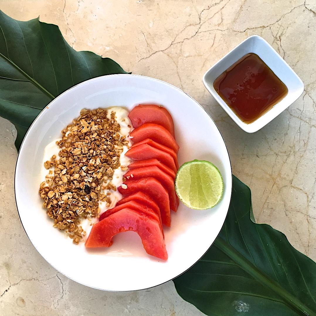 Granola, yogurt and papaya