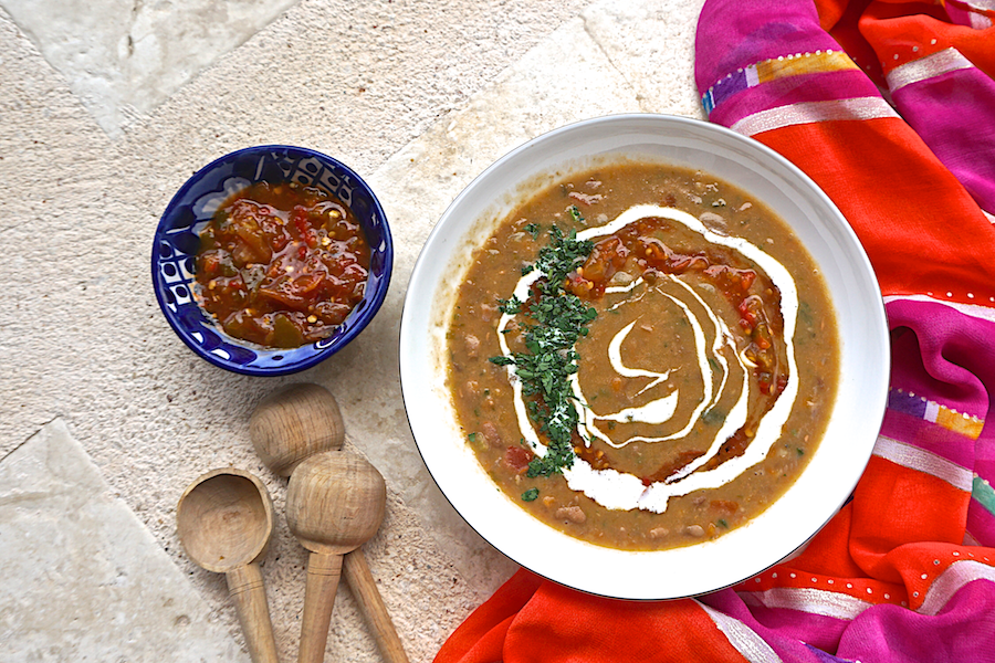Mexican bean soup with salsa and crema
