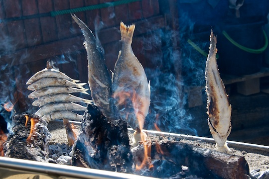 Fish on the grill at a beach restaurant