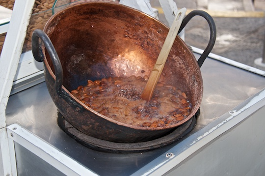Boiling caramel on a street vendor cart