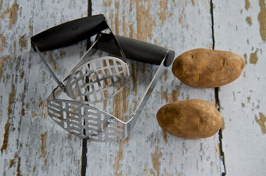 Hand held potato mashers