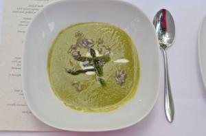 Asparagus soup with goat cheese creme fraiche and chive blossoms