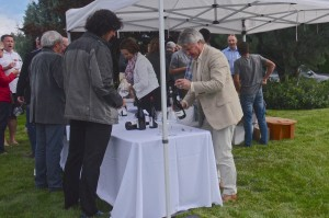 Ingo Grady pouring Mission Hill Pinot