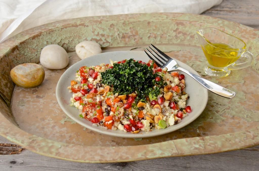 Quinoa cauliflower pomegranate salad with crisp fried kale bits