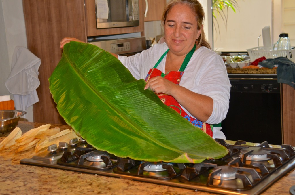 Claudia softening banana leaf for tamales