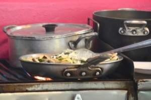 Cooking rajas poblanas at Latitude 20