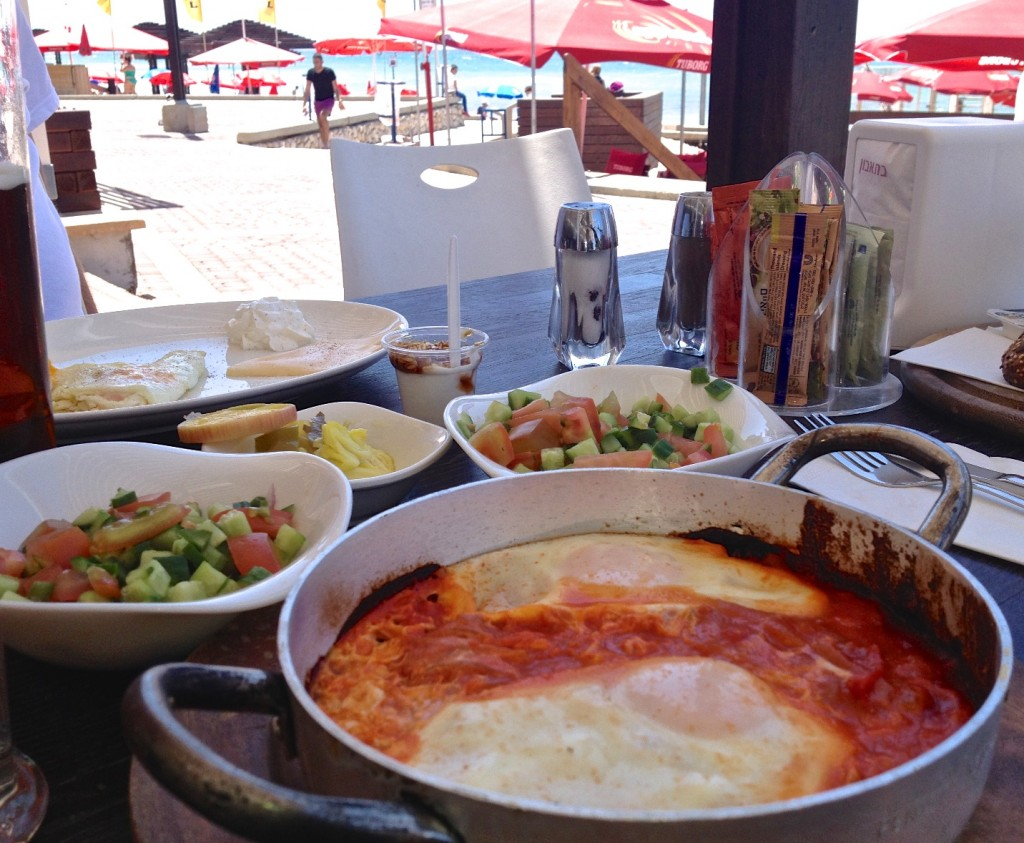 Israeli breakfast shakshuka on the beach in Haifa