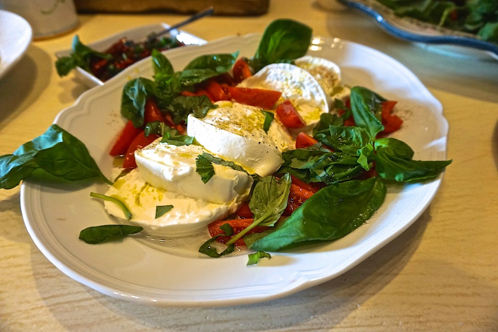 Tomatoes with local fresh mozzarella and basil