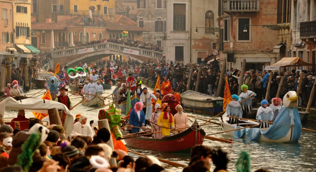 Carnevale di Venezia - gondolas with people dressed in costumes and masks