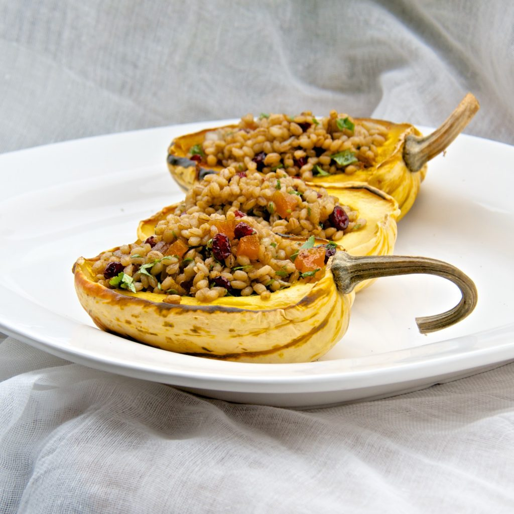 Roasted sweet dumpling squash stuffed with farro pilaf