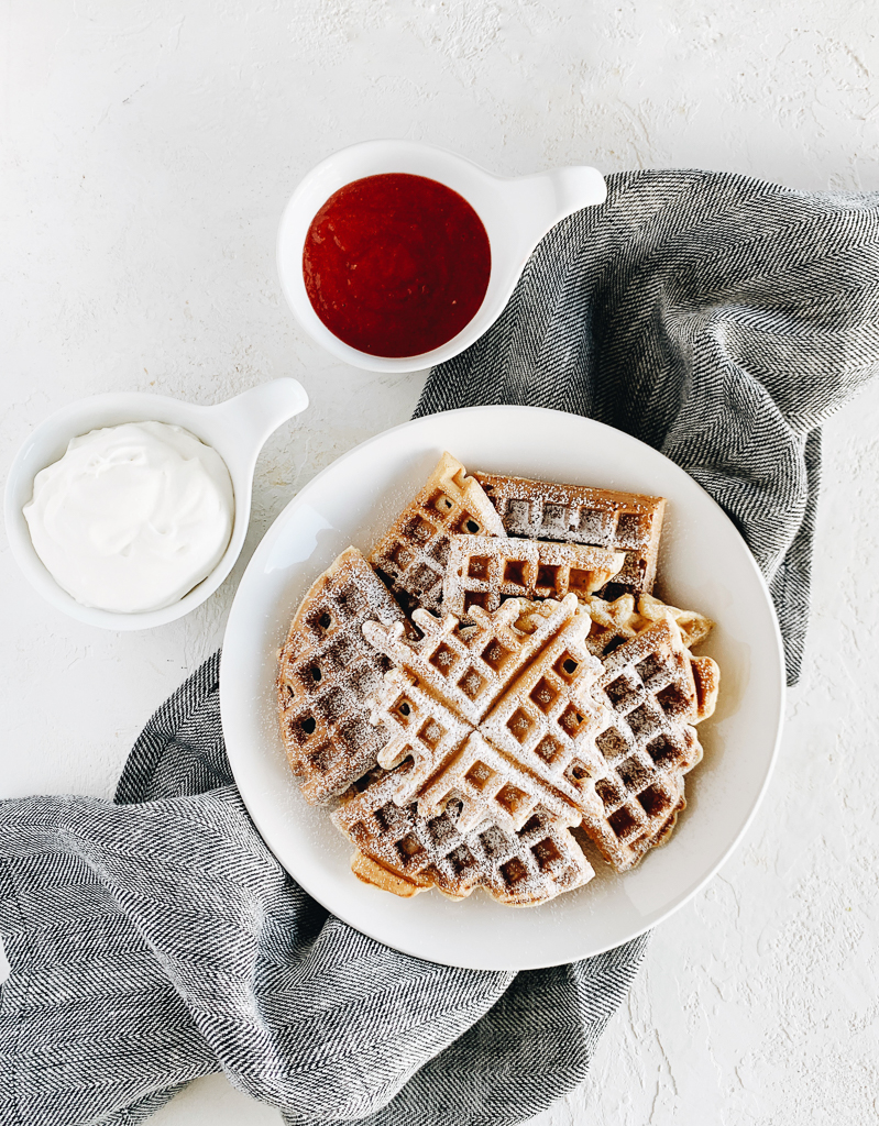 Waffles with oats and strawberry sauce